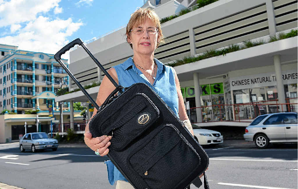 Kate Eagles holds a bag similar to the one she left in the car of a good Samaritan who gave her a lift home on Thursday night.