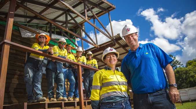 Bechtel QCLNG apprentices and builder Troy Tenheggeler recently helped extend the Nagoorin Hall. Pictured are (from front left) senior project manager Barbara Rusinko, Troy Tenheggeler, (back) Tommy Walters, Andrew Low, Ross McClure, Tony Murphy and Jack Tameki.