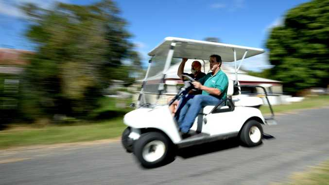 Larry Riley and Rob McIntyre plan to drive a golf buggy to Killarney to raise money for charity. Photo Allan Reinikka / The Morning Bulletin