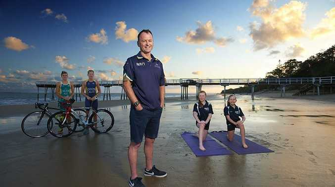 Maths teacher and champion triathlete Brian Harrington of Kawungan is on the cover of this year's Maryborough White Pages and Yellow Pages.