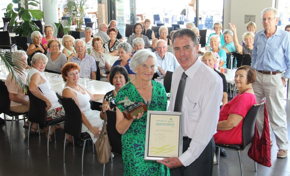 Moya Mateer is presented with a certificate of appreciation for teaching Tai Chi by Fraser Coast Mayor Gerard O'Connell.
