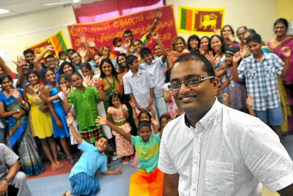 Organiser Aruna Jayasuriya (front) with other community members celebrating the Sri Lankan New Year at the Gladstone Community Hub.