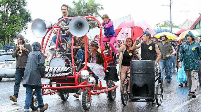 RAINY MALENY: Drizzling rain didn't stop the more than 30 protesters from declaring that 10 years on, they were still not happy about the Woolworths supermarket in the hinterland town.