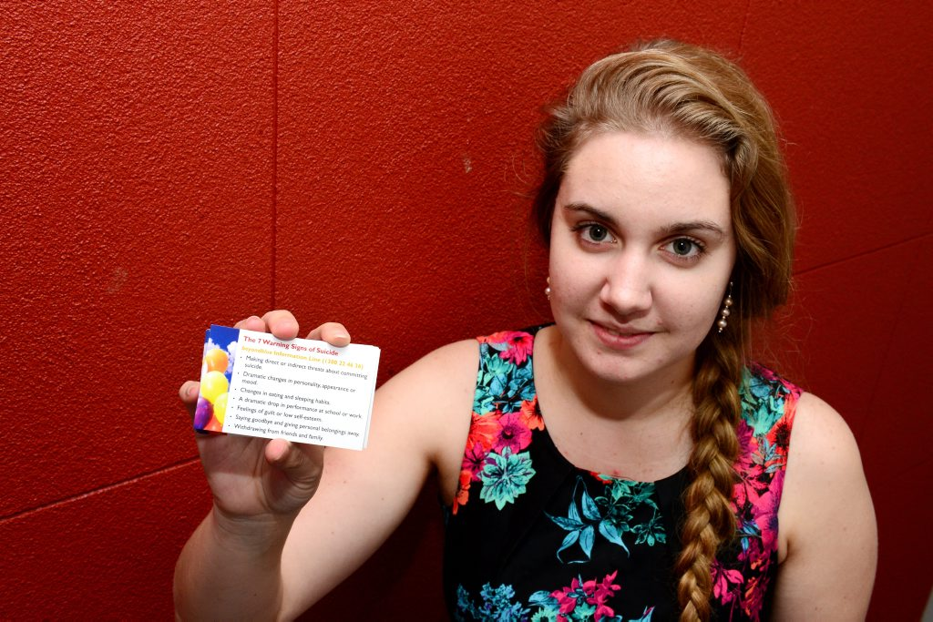 Tiana Ruckert is promoting a card featuring the seven signs of suicide, a project that has also been turned into a video. Photo Sharyn O'Neill / The Morning Bulletin
