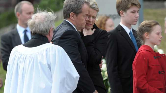 Federal Opposition leader Bill Shorten and his wife Chloe Byrce (C) embrace after the funeral of Shorten's mother, Dr Ann Shorten at Xavier College Chapel in Melbourne, Tuesday, April 15, 2014. Dr Ann Shorten died on April 6. (AAP Image/Julian Smith) NO ARCHIVING