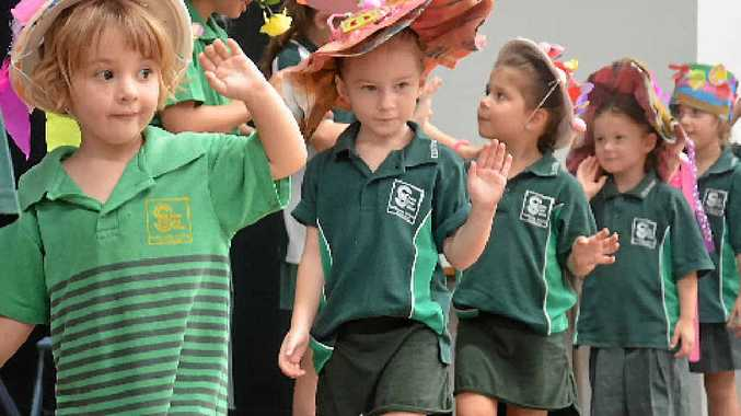 Yashminah Harwood, Tamika Hughes, Indie Ibbotson, Chelsea Rowe and Kodi James participate in Clinton State School's annual Easter bonnet parade.