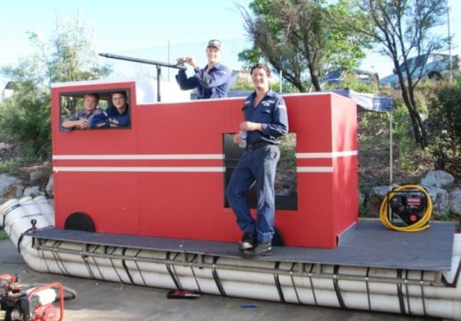 Apprentices Hayden Caughey, Joe Richardson, Luke Neill and Jayden Adams put the finishing touches on NRG's entry in the 2014 Gladstone Harbour Festival Great Raft Race.