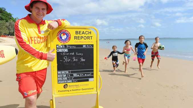 Torquay Beach lifeguard Dominic Merrett gives the thumbs up to the beach conditions after the remains of cyclone Ita passed to the east of Fraser Island. (L) Kaya and Allegra Kusi from London and their cousins Jasper and Retief Padget from Hervey Bay were happy to see the weather improve.