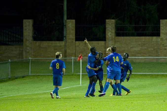 CELEBRATION: South-West players enjoy Daniel Fuller's extra-time goal against Willowburn.