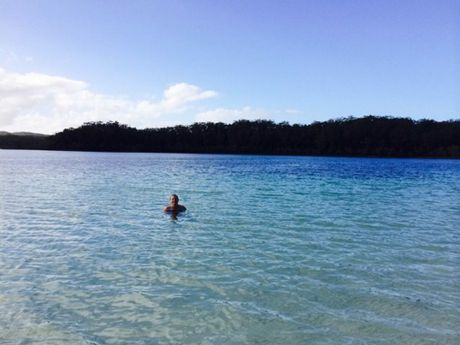 Kingfisher Bay Resort house guest Renae Trimble on her morning swim at Lake McKenzie on Fraser Island on Tuesday.