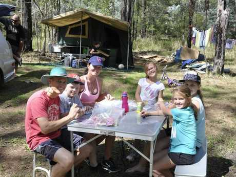 Families set up for a big weekend of camping at Murphy's Creek Escape campgrounds. (From Left )Mick Stevens, Reagen Filce, Tracey Stevens, Sienna Stevens, Teneal Filce, Tahlia Stevens Photo Nick Houghton / The Chronicle