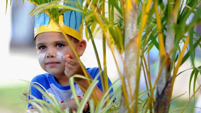 Jett, 4, finds an Easter egg hidden among the greenery at the Maryborough World of Learning easter egg hunt.