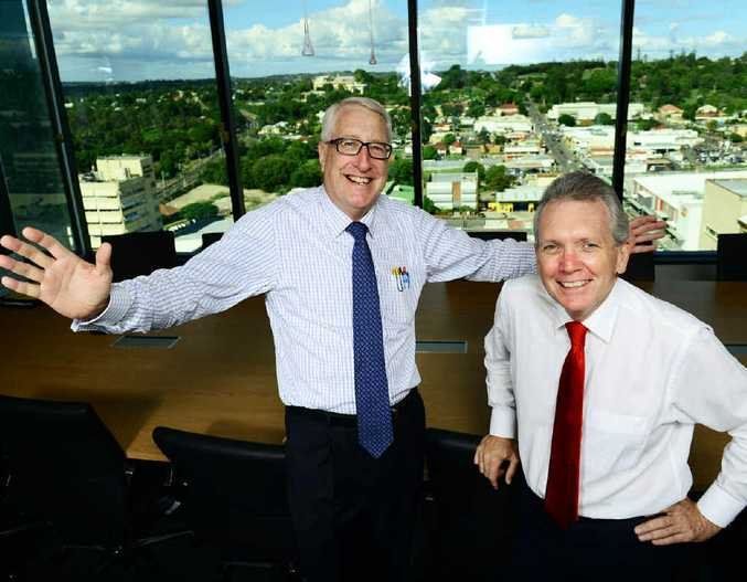 WATER WORKS: Water Supply Minister Mark McArdle (right) and Ipswich MP Ian Berry tour the new SEQ Water offices in Icon Ipswich.