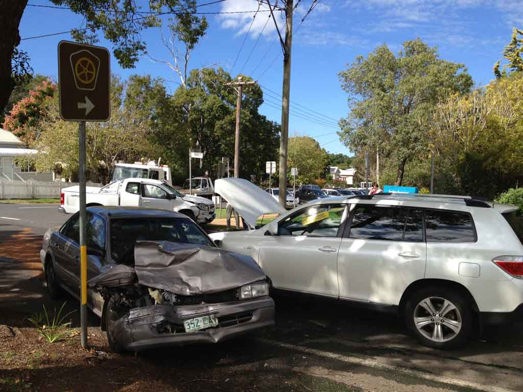 A three-vehicle crash at the intersection of Bridge and Lindsay Sts, Toowoomba.