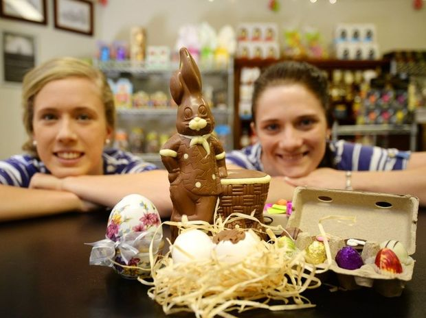Anna Murphy and Janae Carige at the Sam Wray Chocolates store in Kern Arcade, get ready for the busy Easter period. Photo Allan Reinikka / The Morning Bulletin