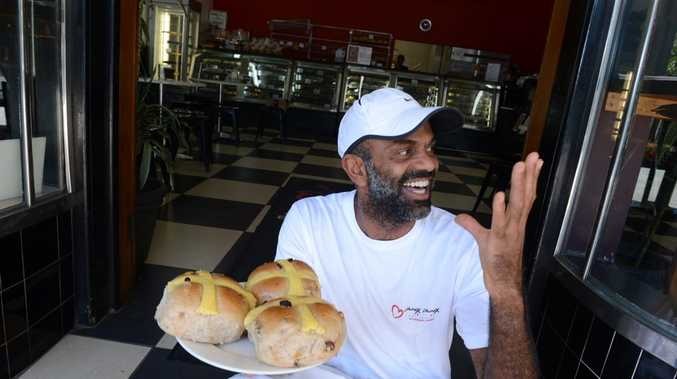 Oliver Bikoumou, chef at Choux Choux Patisserie in Bangalow, with his sought after hot cross buns. Photo Cathy Adams / The Northern Star