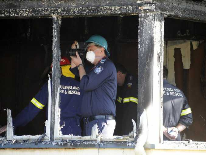 Investigators at the scene of the house fire in Gaydon Street, Newtown.