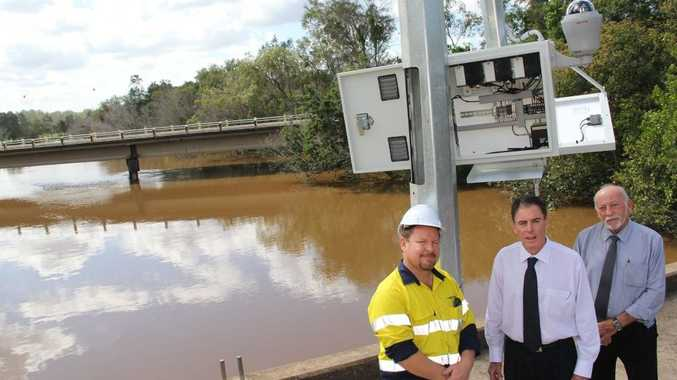 Glen Klingberg from Prospect Environmental explains the workings of the new flood monitor camera on the old bridge over Saltwater Creek to Fraser Coast Mayor Gerard O'Connell and disaster planning co-ordinator Mal Churchill.
