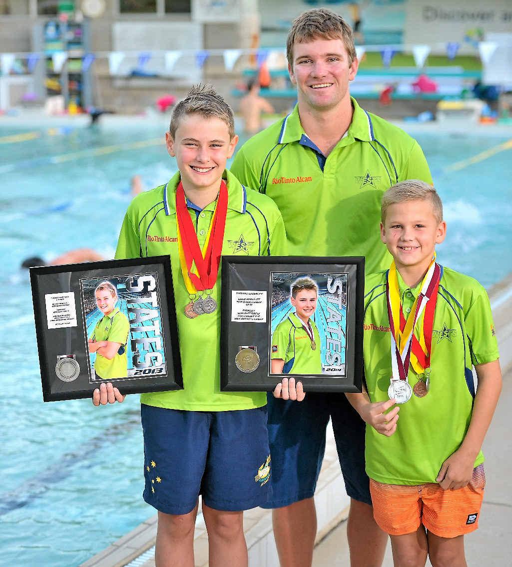 Thomas Crossley, 11, coach Adam Eiseman and Jai Hansen, 10.