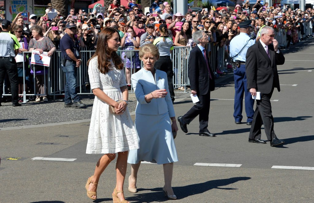 Catherine (L), the Duchess of Cambridge, walks with Jennifer Dudley (C), wife of Glenn Dudley, president of the Royal Agricultural Society of New South Wales.