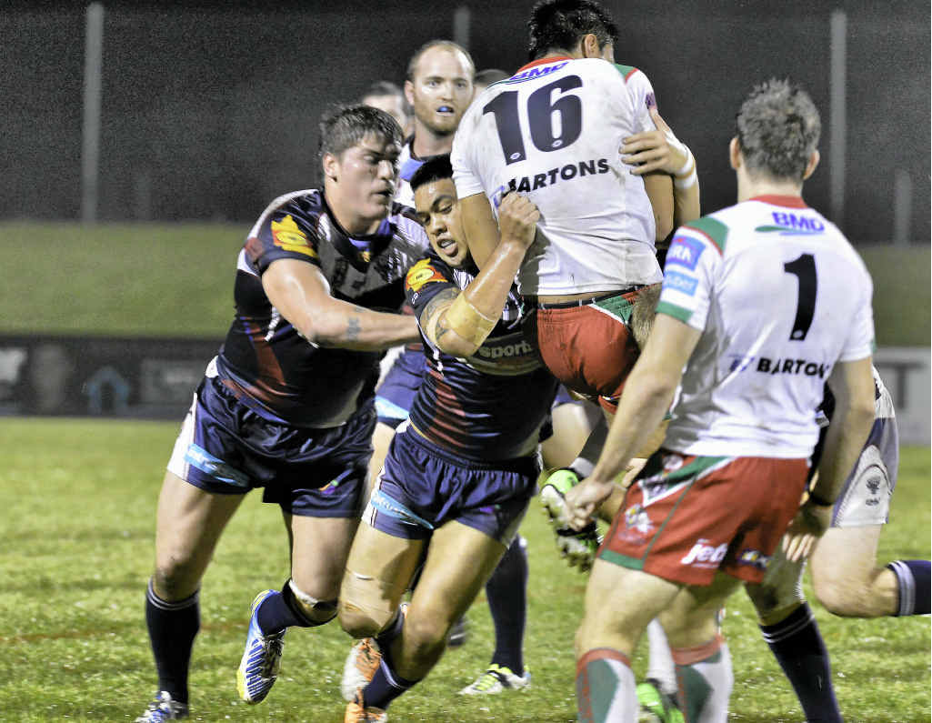 Smith Samau puts in a big tackle for the Capras against Wynnum Manly Seagulls on Thursday night.