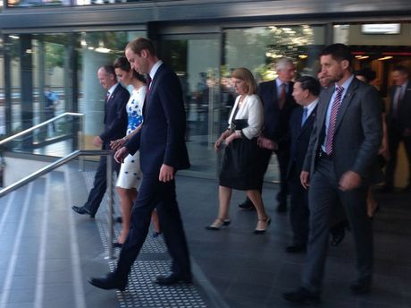 The Duke and Duchess of Cambridge walk out of the Brisbane Convention Centre after meeting a group of Queenslanders.
