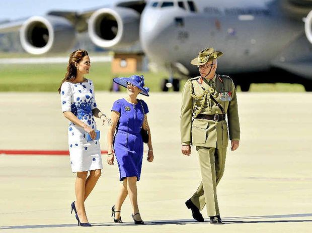 The Duchess talks with Mrs Linda Hurley and her husband, Chief of the Defence Force General David Hurley, after arriving at Amberley.