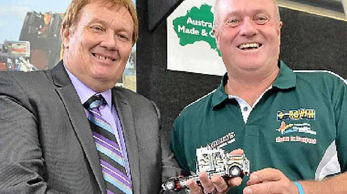 MOVING TRIBUTE: Bruce Hay and Craig Membrey, at ITTES 2014, with the Rowan truck model.