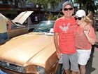 Gus Reid and Mandy Eberhardt check out the lines of some vintage cars during Easter celebrations in Mackay.