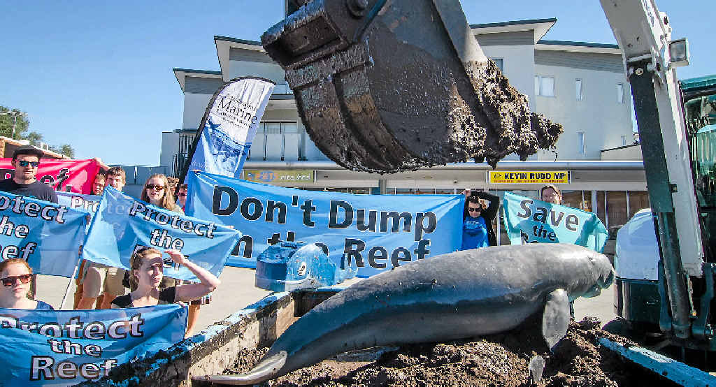 Dredged muck was dumped in front of former Prime Minister Kevin Rudd's Brisbane office to protest dredging near the Great Barrier Reef.