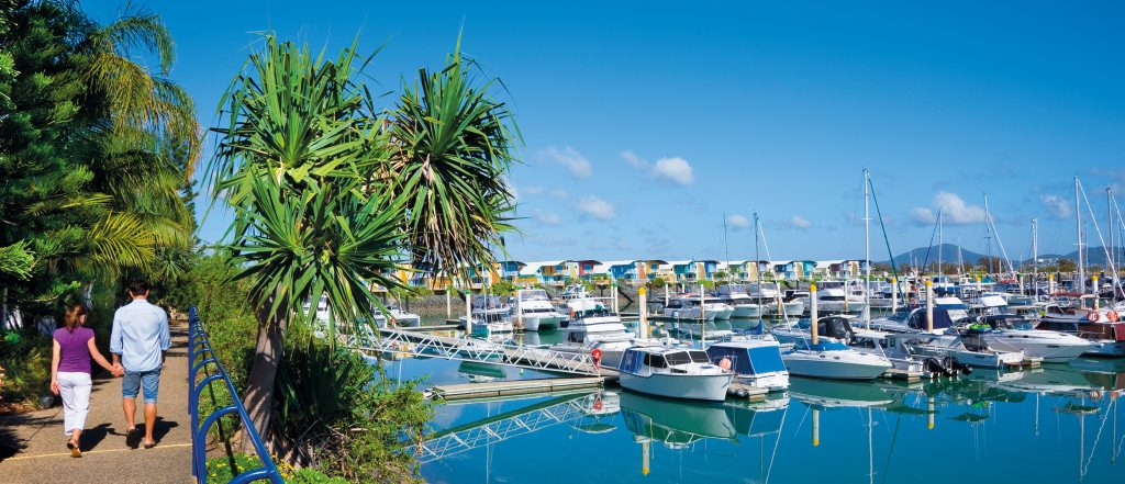 Strolling along the sidewalk next to Keppel Bay Marina. Photo Courtesy of Tourism and Events Queensland