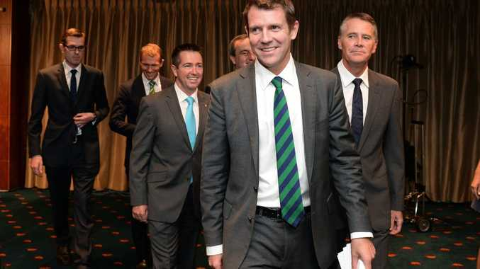 NSW Premier Mike Baird (centre) and Deputy Premier Andrew Stoner (R), along with new cabinet appointees, leave after holding a press conference to announce new members of cabinet, in Sydney, Tuesday, April 22, 2014. The new cabinet will be sworn in at Government House tomorrow. (AAP Image/Dan Himbrechts) NO ARCHIVING