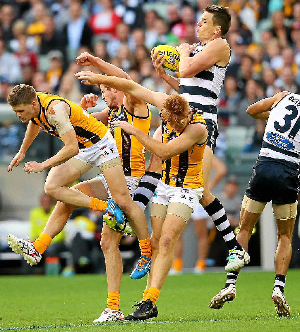 Hamish McIntosh of the Cats marks in amongst a pack of Hawthorn players at the MCG yesterday.