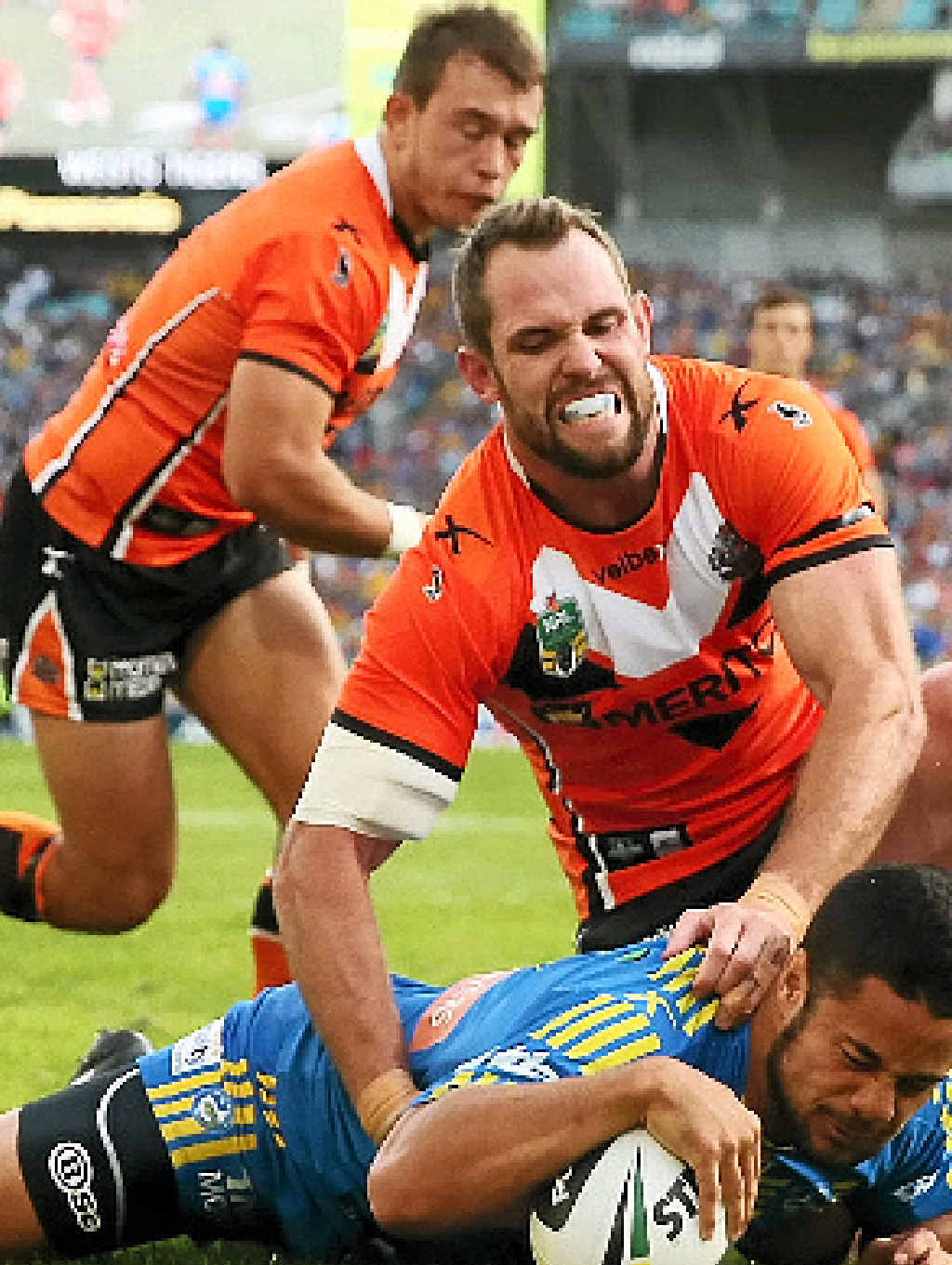 Jarryd Hayne of the Eels scores a try in the game against the Wests Tigers yesterday.
