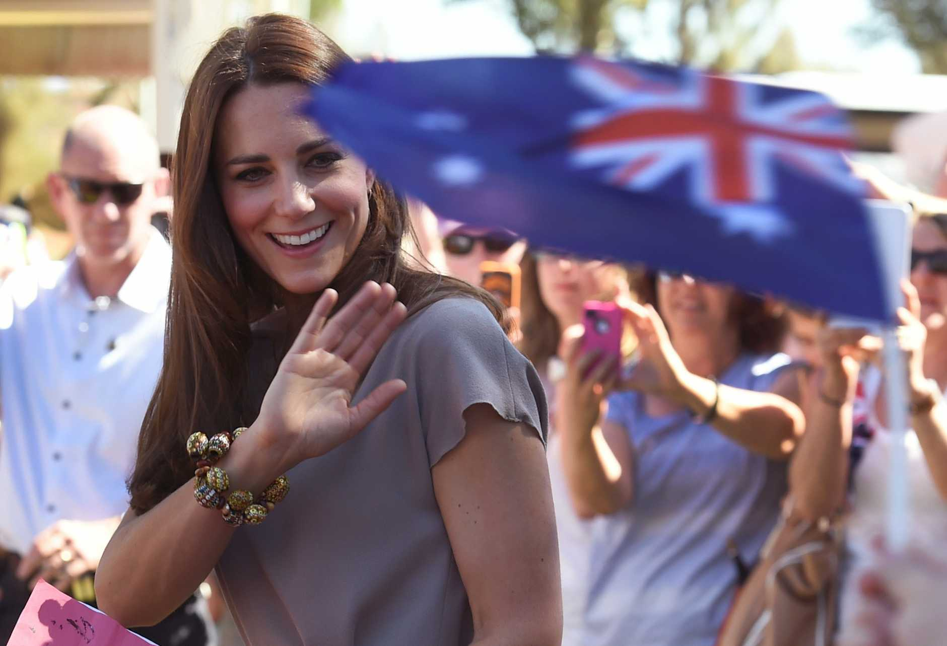 The Duchess of Cambridge, Catherine (L) waves to school children during a visit to the National Indigenous Training Academy at Yulara in the Northern Territory on Tuesday, April 22, 2014. Prince William, his wife Kate and their son Prince George are on a three-week tour of New Zealand and Australia
