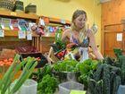 Vegetarian Amy Joyce looking over fresh produce.