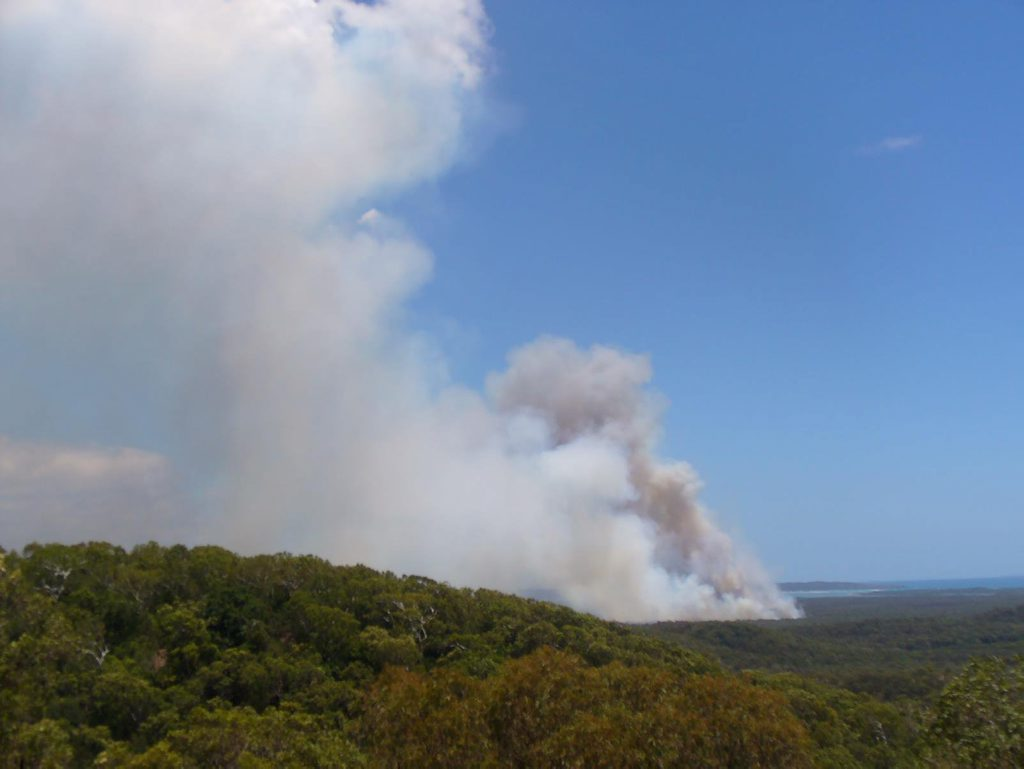 HEAVY SMOKE: A Yeppoon reader sent in this photo of the fire that has been burning in the area since Monday. QFRS said the heavy smoke seen on Christmas Eve was caused by melaleuca burning. Photo Contributed