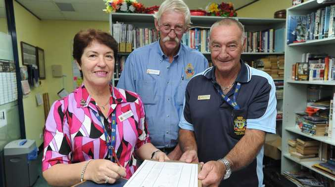 Hervey Bay RSL Sub-Branch office manager Christine Krupa has won a national award. She is pictured with president John Kelsey and vice-president Brian Tidyman.