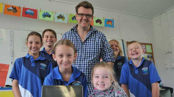 Buliyan State School's (back) Dani Pemen, 12, Asiah Mooney, 11, teaching principal Will Ashburn, Jesse Coogan, 11, Coby Hudson, 9, (front) Chloe Keitley, 8, and Emma-Jean Manley, 6, with one of the iPads the school won in The Observer's iPads for Schools competition.