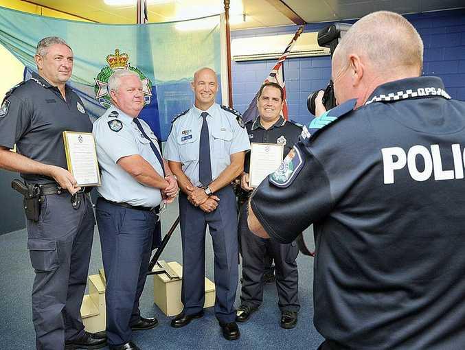 Police award recipients Senior Constable Ed Gompelman, Sergeant Trevor Ferling, Inspector Paul Biggin and Sergeant Nev Zarkovich have their photo taken by Sergeant Paul Reason.