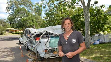 Rodger and Charly Bradshaw are distraught after a large tree fell on their bus in Eumundi. Photo: Warren Lynam / Sunshine Coast Daily