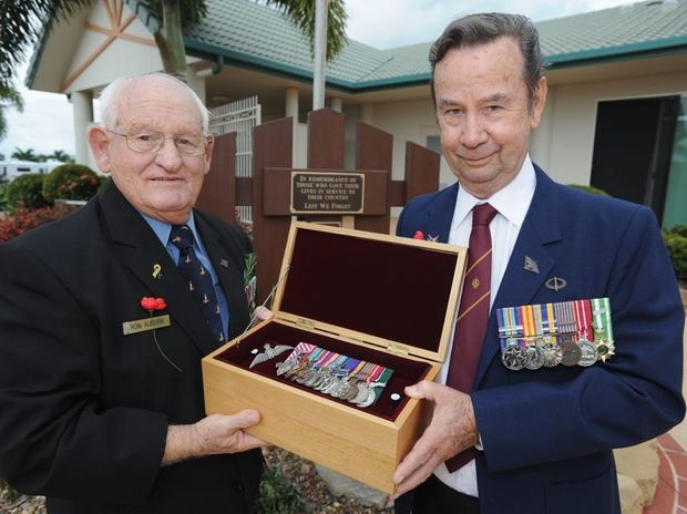 Ron Auburn and Frank McLean at the Fraser Shores 2 memorial with the medals of their mate Jim Wilson who died in December.