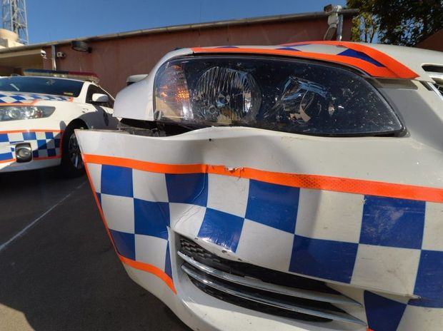 Police vehicles were damaged on Thursday night, after a man rammed vehicles, before leading officers on a chase and making a bomb hoax at QAL.