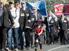 Harrison Luxford marches with his grandfather John Atkins and the Vietnam veterans in the Anzac Day 2014 march, Friday, April 25, 2014. Photo Kevin Farmer / The Chronicle