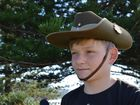 Brody Carlin wears his dad's hat during the Yamba Anzac Day service. Photo Georja Ryan / Daily Examiner