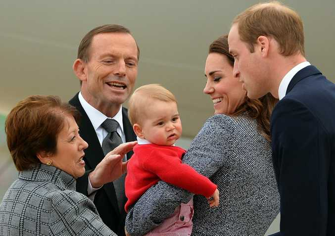 Lynne Cosgrove (L), wife of Governor-General of the Commonwealth of Australia Peter Cosgrove (unseen), and Australian Prime Minister Tony Abbott (2nd L) sees off Britain's Prince William (R), his wife Catherine (2nd R), the Duchess of Cambridge, and their son Prince George.