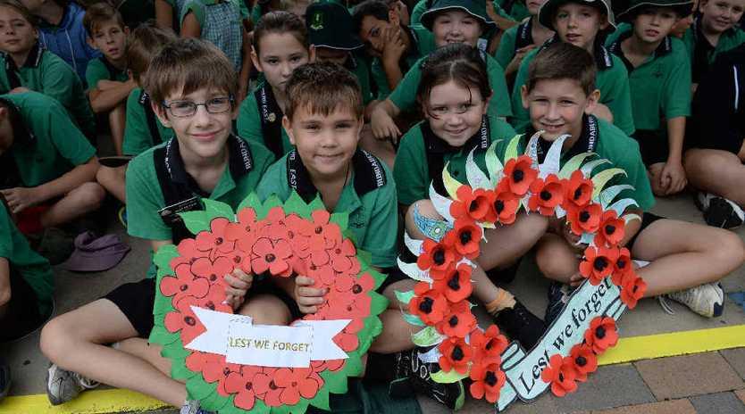 Liam Doyle, Kenieth Baumgarten, Hayley Richardt and Rhys Garland with their wreaths.