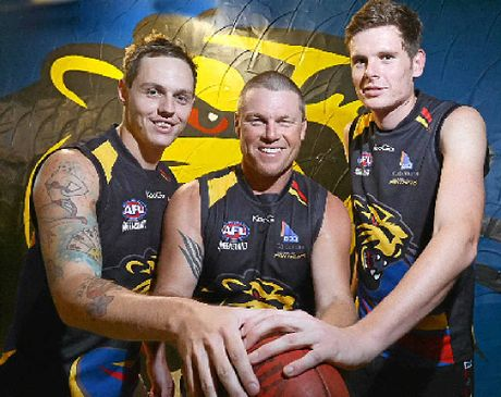HONOURING MATE: AFL players Quiten Ross, Tim Francis and Mick D'Arcy will take part in Dozer Day to remember Wayne Dover.