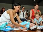 Mums and bubs at the attempt for a Guinness World Record for the most number of cloth nappies changed at the same time, at Millwell Rd Community Centre, Maroochydore. Photo: Iain Curry / Sunshine Coast Daily