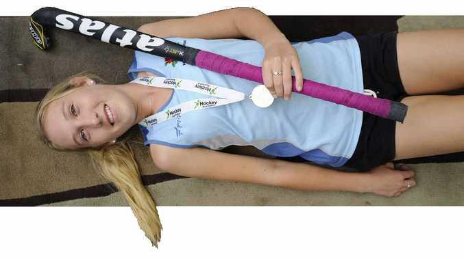 PLAYING THE BLUES: Hockey star Sarah Donnolley. Photo: JoJo Newby